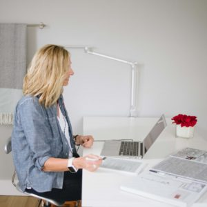Professional Organizer Cheryl at a laptop