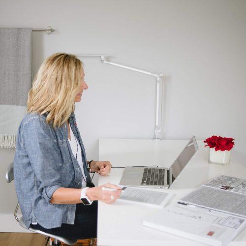 Professional Organizer sitting at laptop